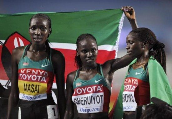 Vivian Cheruiyot of Kenya celebrates with her teammates after winning the women's 10,000 metres final at the IAAF World Championships in Daegu