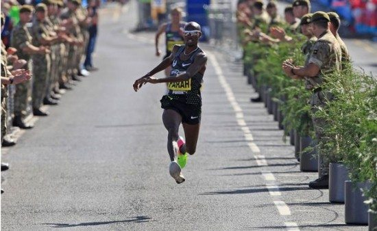 Britains-Mo-Farah-acts-out-a-kick-as-he