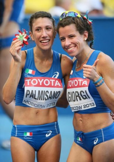epa03822769 Italy's Antonella Palmisano (L) and Eleonora Giorgi (R) react after competing in the women's 20km Walk at the 14th IAAF World Championships at Luzhniki stadium in Moscow, Russia, 13 August 2013.  EPA/SERGEI ILNITSKY