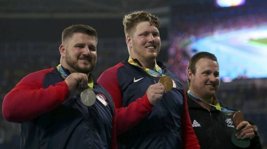 2016 Rio Olympics - Athletics - Victory Ceremony - Men's Shot Put Victory Ceremony - Olympic Stadium - Rio de Janeiro, Brazil - 18/08/2016. Gold medalist Ryan Crouser (USA) of USA, silver medalist Joe Kovacs (USA) of USA, and bronze medalist Tomas Walsh (NZL) of New Zealand pose. REUTERS/Gonzalo Fuentes  FOR EDITORIAL USE ONLY. NOT FOR SALE FOR MARKETING OR ADVERTISING CAMPAIGNS.