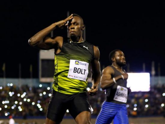 Jamaica's Olympic champion Usain Bolt (L) gestures after winning his final 100 meters sprint at the 2nd Racers Grand Prix at the National Stadium in Kingston, Jamaica June 10, 2017. REUTERS/Gilbert Bellamy