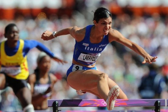 LONDON, ENGLAND - AUGUST 06:  Marzia Caravelli of Italy competes in the Women's 100m Hurdles heat on Day 10 of the London 2012 Olympic Games at the Olympic Stadium on August 6, 2012 in London, England.  (Photo by Michael Regan/Getty Images)