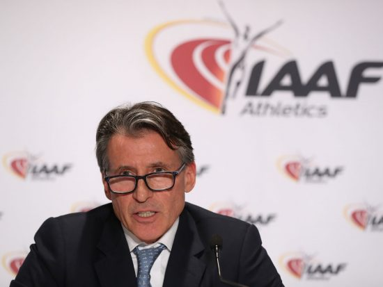 Sebastian Coe in front of IAAF logo
