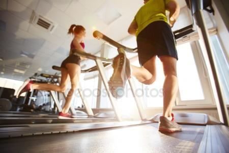depositphotos_112568402-stock-photo-people-running-on-treadmills