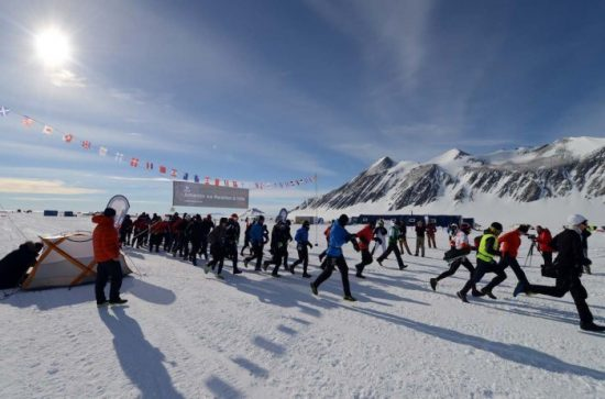 The start, Andrew Murray extreme right. The southernmost marathon in the world, the Antarctic Ice Marathon, took place at Union Glacier, Antarctica on 21st November. Fifty competitors representing 16 countries across the globe took part in the event. Eleven competitors were running a marathon on their seventh continent. The official Marathon Flame was also present at the event. Athletes traversed a course of snow and ice in sub-zero temperatures. More info @ www.icemarathon.com