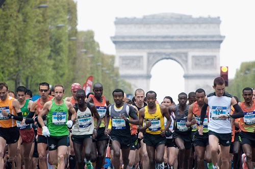 PARIS, FRANCE - APRIL 15: Competitors run during the 36th Paris Marathon on April 15, 2012 in Paris, France. (Photo by Trago/Getty Images)