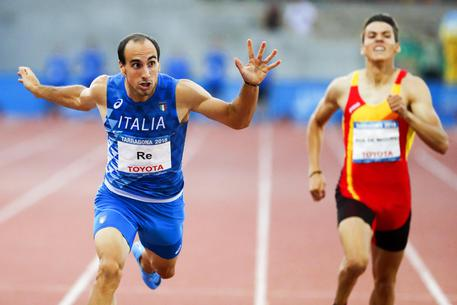 epa06848473 Davide Re (L) of Italy crosses the finish line to win the men's 400m final of the Athletics events at the XVIII Mediterranean Games in Tarragona, Spain, 28 June 2018.  EPA/DAVID AGUILAR