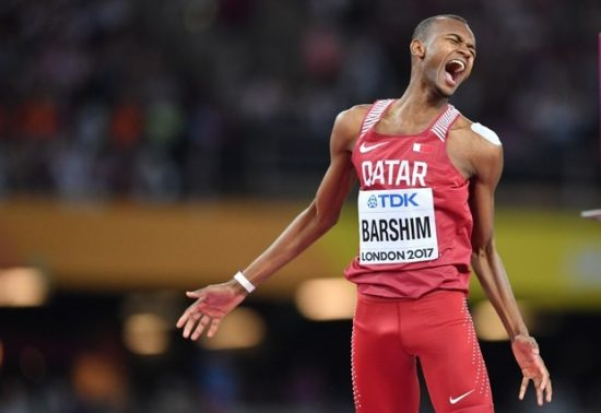 Qatar's Mutaz Essa Barshim celebrates winning gold in the final of the men's high jump athletics event at the 2017 IAAF World Championships at the London Stadium in London on August 13, 2017. / AFP PHOTO / Andrej ISAKOVIC