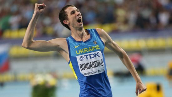 Ukraine's Bohdan Bondarenko celebrates after winning the men's high jump final at the 2013 IAAF World Championships at the Luzhniki stadium in Moscow on August 15, 2013.  AFP PHOTO / ALEXANDER NEMENOV        (Photo credit should read ALEXANDER NEMENOV/AFP/Getty Images)