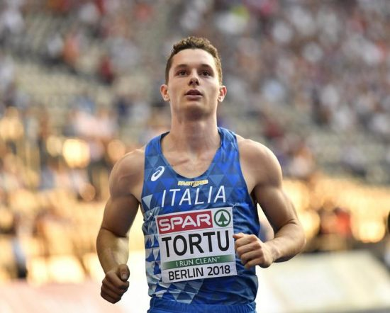 Italy's Filippo Tortu checks his time after a men's 100-meter semifinal at the European Athletics Championships in Berlin, Germany, Tuesday, Aug. 7, 2018. (ANSA/AP Photo/Martin Meissner) [CopyrightNotice: Copyright 2018 The Associated Press. All rights reserved]