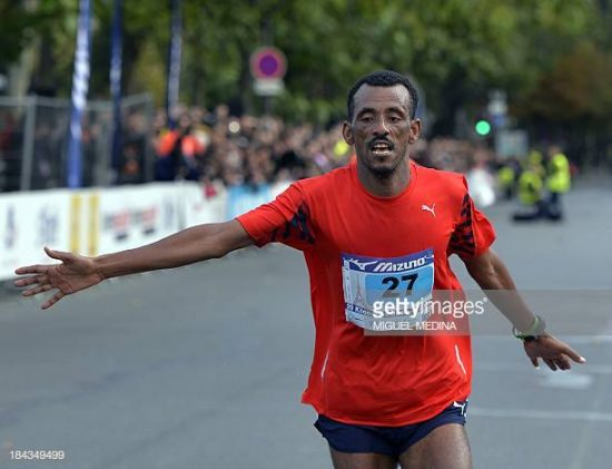 Ethiopian athlete Tebalu Zawude Heyi wins the 35th edition of the 20 kilometres of Paris on October 13, 2013. AFP PHOTO/MIGUEL MEDINA (Photo credit should read MIGUEL MEDINA/AFP/Getty Images)