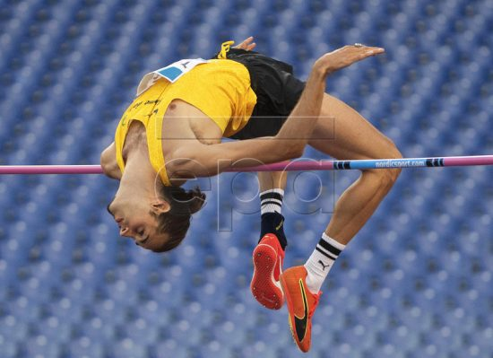 epa07631200 Gianmarco Tamberi of Italy competes in the men's High Jump event of the Golden Gala - Pietro Mennea athletics meeting as part of the IAAF Diamond League at the Olympic stadium in Rome, Italy, 06 June 2019. EPA-EFE/MAURIZIO BRAMBATTI