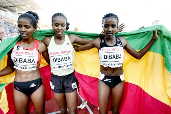 Tirunesh Dibaba of Ethiopia (R) poses with her sisters Genzebe (L) and Ejegayehu (C) after setingt a new world record in the women's 5000m Golden League event at Bislett stadium in Oslo on June 6, 2008. The 22-year-old reigning two-time world 10,000m champion, running at the second of the six-meet Golden League series, finished in 14min 11.15sec, smashing the previous record of 14:16.63 set by compatriot Meseret Defar at last year's Bislett Games in Oslo. AFP PHOTO / Stian Lysberg Solum/ scanpix