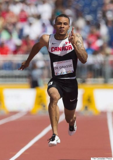 Andre De Grasse of Canada finishes first in his men's 100-metre heat during the athletics competition at the Pan Am Games in Toronto, Tuesday July 21, 2015. THE CANADIAN PRESS/Mark Blinch