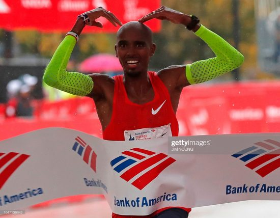 Mo Farah of Britain celebrates as he crosses the finish line to win the Chicago Marathon in Chicago, on October 7, 2018. - British athletics star Mo Farah won the Chicago Marathon men's title on Sunday in an unofficial time of 2hr 5min 11sec, shattering a European record with a spectacular finishing surge. The world and Olympic 5,000 and 10,000-meter champion became the first British man to capture the event since Paul Evans in 1996.The 35-year-old Somalia-born Briton claimed the biggest victory since he turned his attention to the distance a year ago to defeat Ethiopia's Mosinet Geremew by 13 seconds with Japan's Suguru Osako third in 2:05:50. (Photo by JIM YOUNG / AFP) (Photo credit should read JIM YOUNG/AFP/Getty Images)