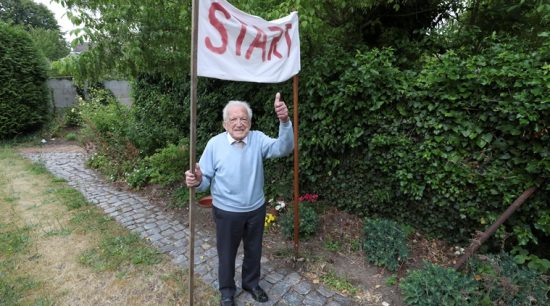 103-year-old Belgian oldest former general practitioner Alfons Leempoels poses next to a start line intending to walk the equivalent of a marathon in his garden to raise money for scientists researching the coronavirus disease (COVID-19) in Rotselaar, Belgium June 9, 2020. REUTERS/Yves Herman