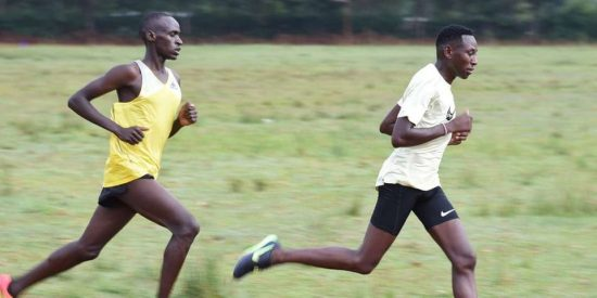 Olympics 3,000m steeplechase Champion Conseslus Kipruto (right), and aother athlete during training at Cheptarit Secondary School ground in Mosoriot, Nandi County on August 06, 2020. Conseslus hired a grader to make the track using his recourses to enable him and other athletes get a place to do speed work. JARED NYATAYA (Eldoret).