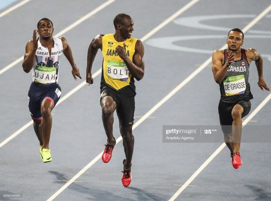 RIO DE JANERIO, BRAZIL - AUGUST 14: Usain Bolt of Jamaica (C) smiles as he looks at Canada's Andre De Grasse (R) in the Men's 100 meter semifinal of the Rio 2016 Olympic Games in Rio de Janeiro, Brazil on on August 14, 2016. (Photo by Salih Zeki Fazlolu/Anadolu Agency/Getty Images)