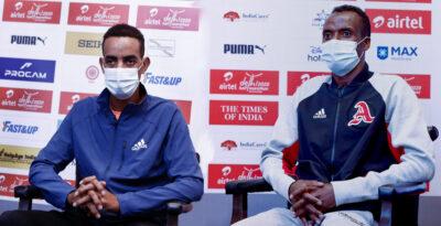 ADHM-2020-L-R-Defending-Champion-Andamlak-Belihu-ETH-with-2017-2019-5000m-world-champion-Muktar-Edris-ETH-400x205