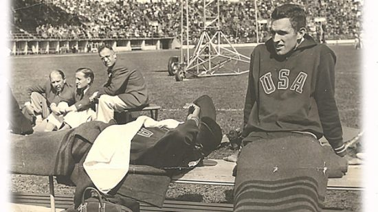 Buddy Davis stays warm during the high jump competition at the 1952 Summer Olympics in Helsinki, Finland. (Courtesy of Museum of the Gulf Coast)
