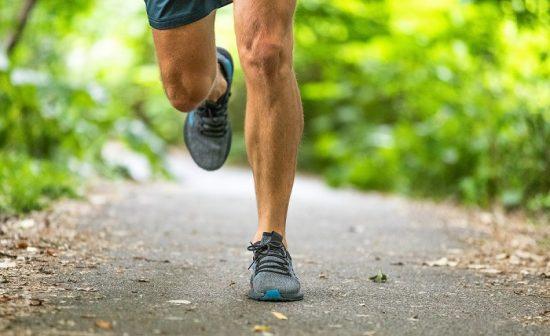 Running man runner athlete workout jogging outdoors on city park