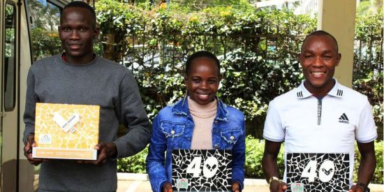 Valencia half marathon in a world record time winner Kibiwott Kandie (left) with Valencia marathon in course record times women and men's winners Peres Jepchirchir (center) and Evans Chebet display their trophies during the reception by Athletics Kenya at Riadha House, Nairobi on December 8, 2020. PHOTO LUCY WANJIRU