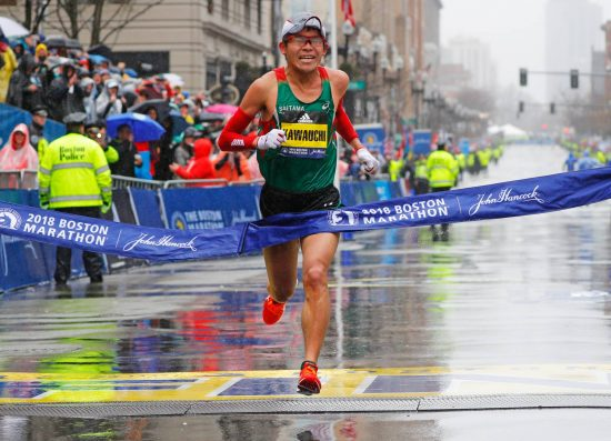 Yuki Kawauchi of Japan crosses the finish line to win the men's division of the 122nd Boston Marathon in Boston, Massachusetts, U.S., April 16, 2018. REUTERS/Brian Snyder
