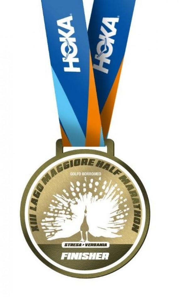 La medaglia della Lago Maggiore Half Marathon, capolavoro di tradizione e bellezza, icona di positività e cambiamento