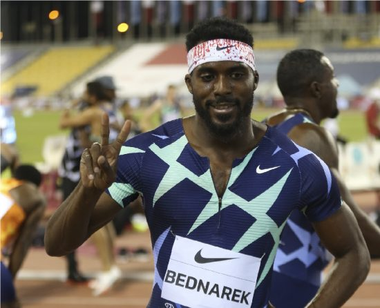 Kenny Bednarek the US celebrates after winning the men's 200m final during a Diamond League track meet in Doha, Qatar, Friday, May 28, 2021. (AP Photo/Hussein Sayed)